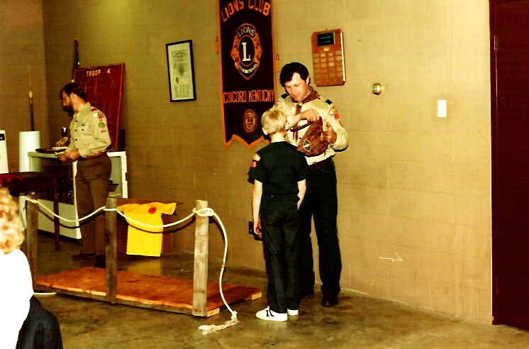 My dad awarding me the Webelo rank in Cub Scouts